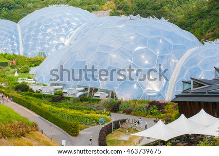 CORNWALL, ENGLAND - JULY 24; Eden Project white geodesic domes surrounded by outdoor gardens a tourist attraction, plant research and environmental education complex July 24, 2013 Cornwall England.