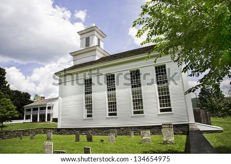 Cornwallville Church, built in 1795, in the historic village at Farmers' Museum, Cooperstown, New York.  In the background is Bump Tavern, built in 1797.