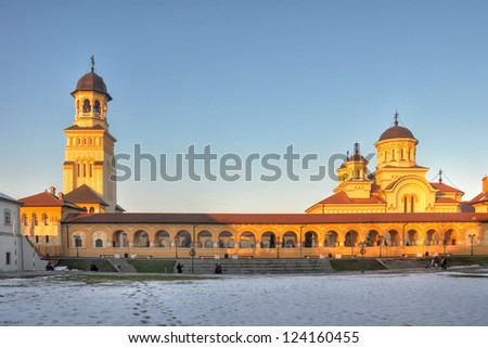 Coronation Cathedral from Alba Iulia fortress surprised at sunset. - stock photo