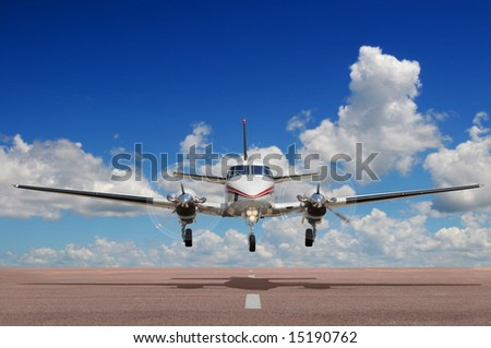 Corporate aircraft landing or taking off during a sunny day