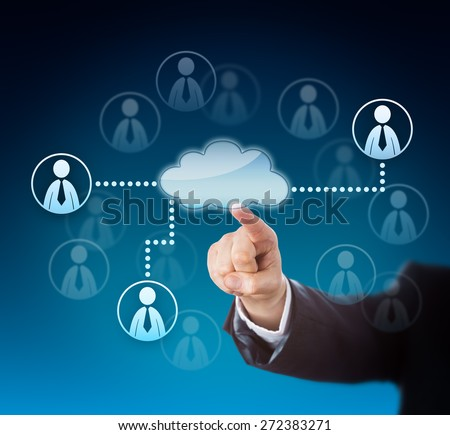 Corporate arm in blue suit activating human resources via touch screen. Finger pressing blank cloud computing icon with copy space in the center of a professional network with many knowledge workers. - stock photo