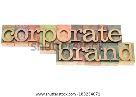 corporate brand - isolated text in letterpress wood type printing blocks stained by color inks - stock photo
