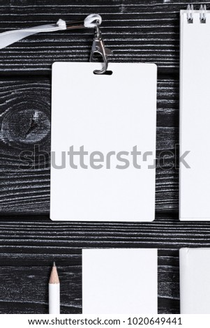 Corporate branding mockup template, isolated on dark wooden background.