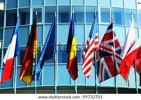 Corporate building with different world flags - stock photo