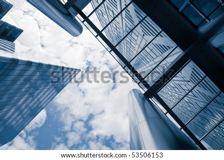 corporate buildings low angle in blue - stock photo