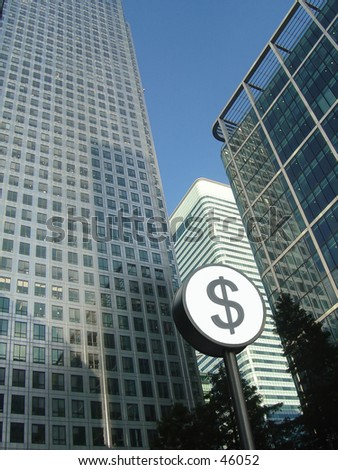 Corporate buildings with Dollar sign in front - stock photo