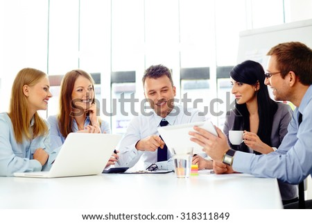 Corporate business people brainstorming new ideas - stock photo