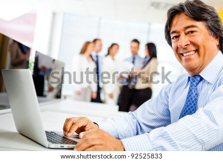 Corporate business worker at the office with a laptop - stock photo