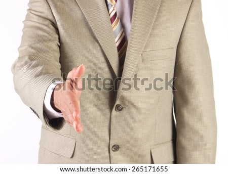 Corporate businessman extending hand to greet and welcome executives - stock photo