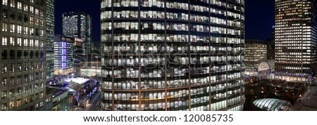 Corporate cityscape at night - stock photo