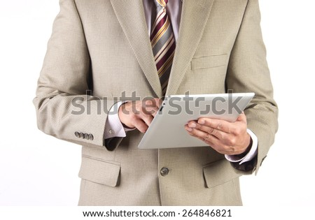 Corporate executive and businessman checking working on a tablet with wifi connectivity - stock photo