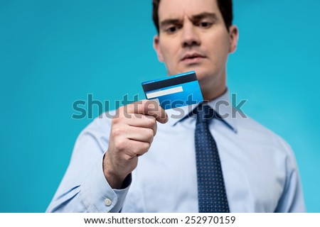Corporate executive looking his debit card - stock photo