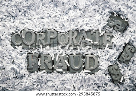 corporate fraud phrase made from metallic letterpress type inside of shredded paper heap - stock photo