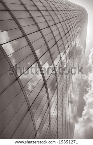 Corporate Glass Against Cloudy Heavens