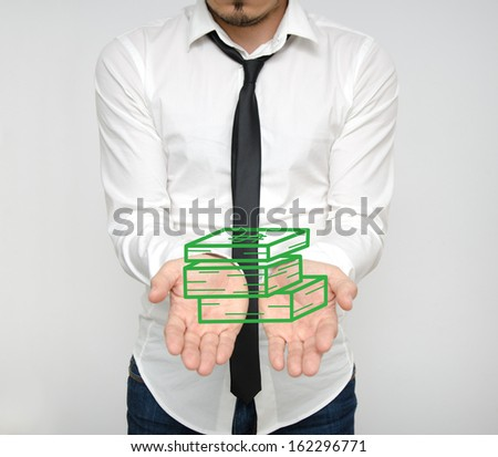 Corporate greed and wealth suggested by a young rich business man entrepreneur with a stack of money in his hands - stock photo
