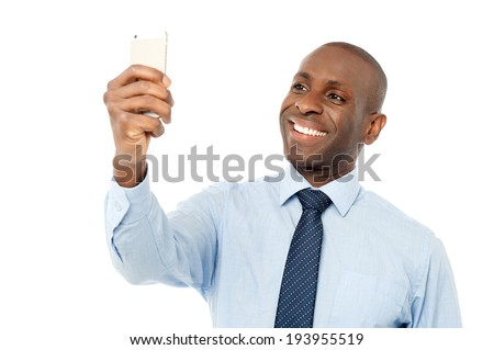 Corporate guy looking his mobile phone - stock photo