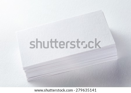 Corporate Identity. An empty business cards on white background.  Great way to present your work to a client. - stock photo