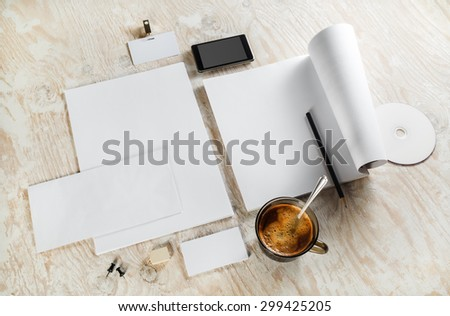 Corporate identity template on light wooden background. Blank stationery set. For design presentations and portfolios. Top view.  - stock photo