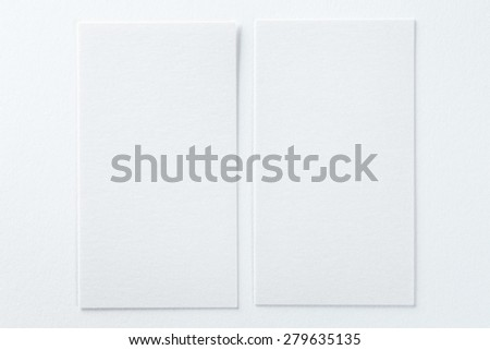 Corporate Identity. Two empty business cards on white background. Great way to present your work to a client - stock photo