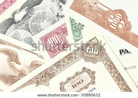 Corporate investing. Old stock share certificates from 1950s-1970s (United States). Vintage scripophily objects. - stock photo