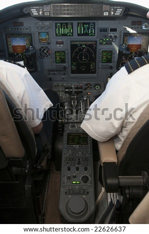 Corporate jet cockpit view with digital instruments - stock photo
