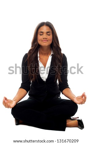 Corporate lady practicing meditation in lotus pose. - stock photo