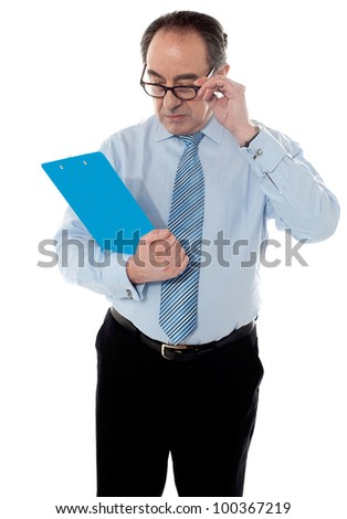 Corporate male holding business document isolated on white background - stock photo