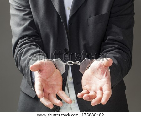 corporate man in bracelets begging for freedom