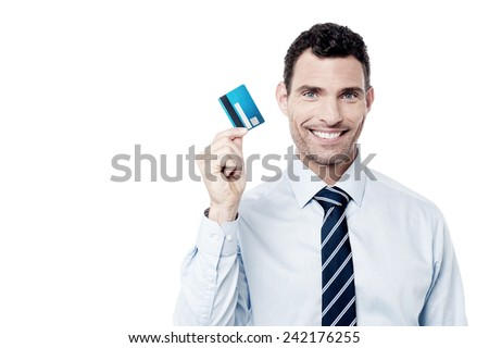 Corporate man showing his credit card - stock photo