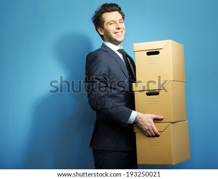 Corporate man with a cardboard box - stock photo