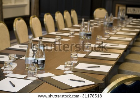 Corporate meeting room with chairs and tables. - stock photo