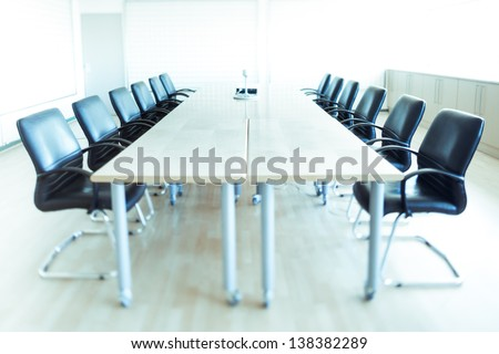 corporate office chairs in a boardroom - stock photo