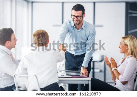 Corporate people shaking hands on a office meeting - stock photo