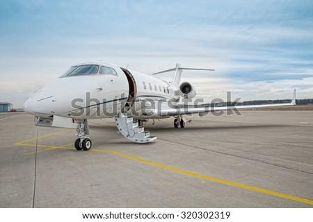 corporate private jet - plane - stock photo