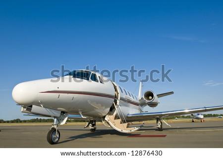 Corporate private luxury jet at airport door open blue sky - stock photo