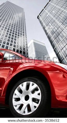 corporate red car wheel close up on a business environment - stock photo