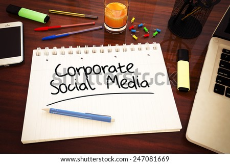 Corporate Social Media - handwritten text in a notebook on a desk - 3d render illustration. - stock photo