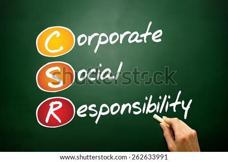 Corporate Social Responsibility (CSR), business concept acronym on blackboard - stock photo