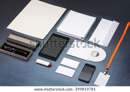 Corporate stationary.Branding mock-up.Tablet,smart phone,cd,id card,pen case,lighter and business cards on op of blue background. - stock photo