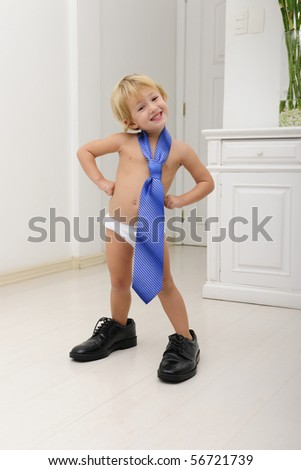 Corporate succession: child with father?s tie and shoes posing