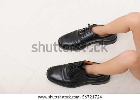 Corporate succession: child with father?s tie and shoes with copy space