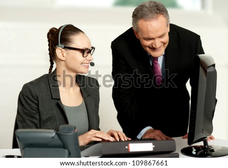 Corporate team working together on computer. Creating database of customers - stock photo