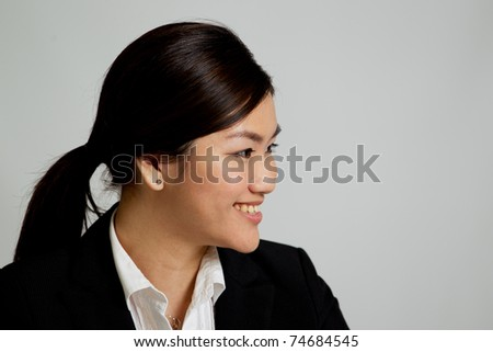 Corporate themed image of a business woman - stock photo