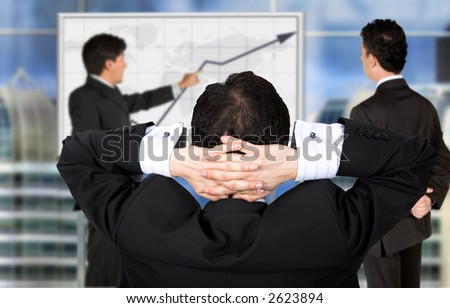Corporate trainning in an office screen with the boss relaxing - stock photo
