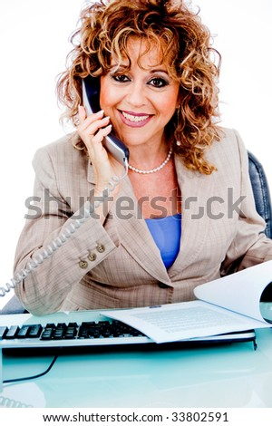 Corporate woman busy with file work and answering calls - stock photo