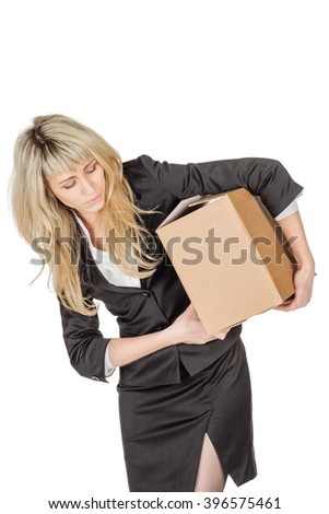 Corporate woman holding a pile of boxes against a white background. business and delivery service concept - stock photo