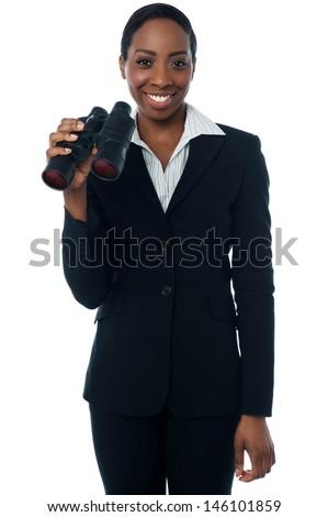 Corporate woman holding binoculars - stock photo