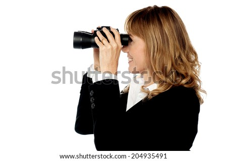 Corporate woman with binoculars searching for business - stock photo