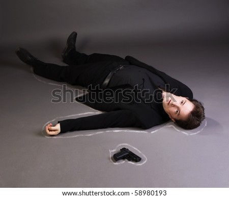 Corpse of business man lays on a floor