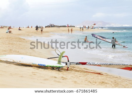 Corralejo, Fuerteventura, Spain - November 2014 - windsurfer going to the water from the beach detail close up